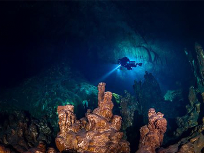 Underwater photo of diver in cave