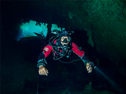 Photo of underwater diver in cavern
