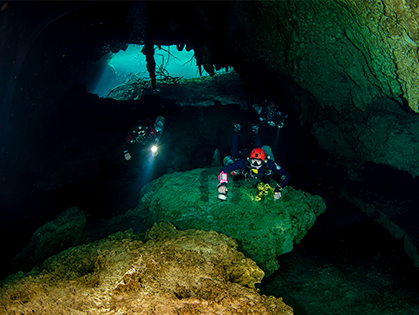 Photo of two divers in cavern