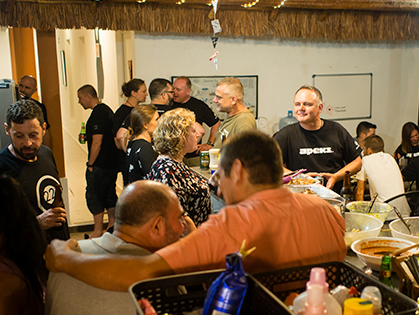 Photo of people socializing in a palapa bar