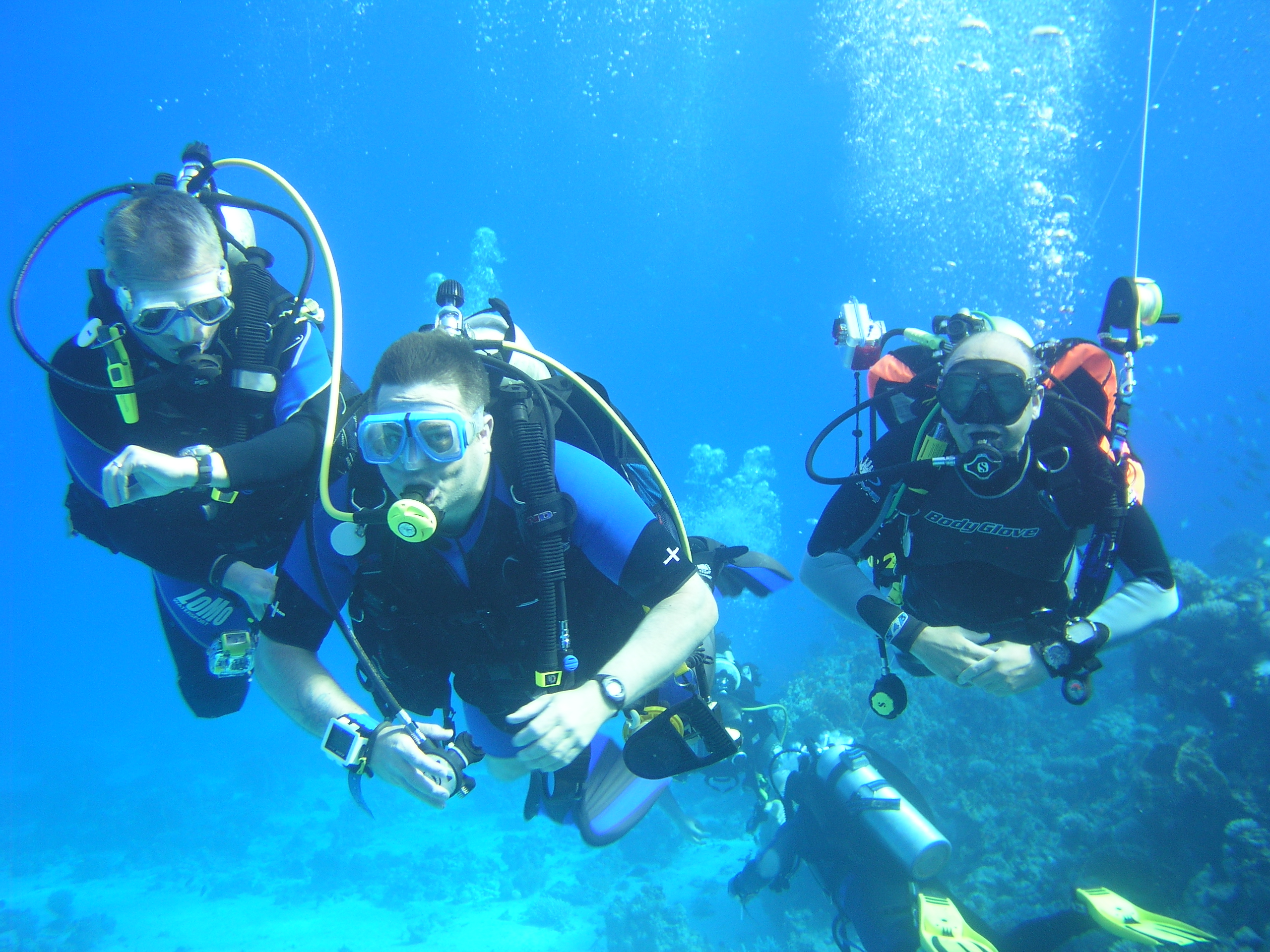 Underwater photo of three divers