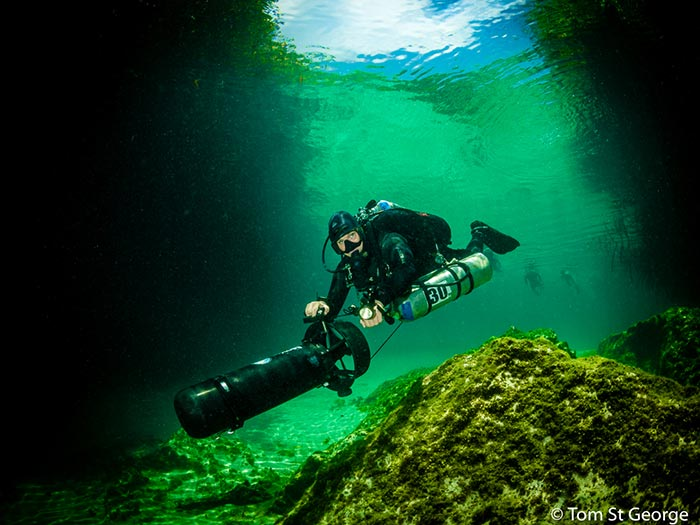 Underwater photo of diver with scooter