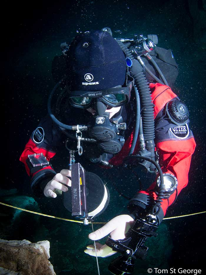 Underwater photo of diver in red dry suit